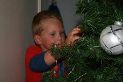 Ethan decorates the Big Fake Tree
