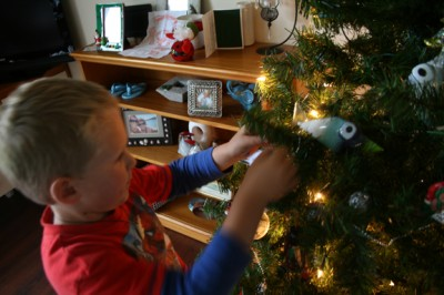 Ethan decorates the Big Fake Tree 2